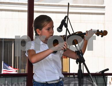 Kaitlyn Decker takes the stage to compete in the Small Fry 9 & Under Division at the 87th Annual Athens Old Fiddlers Contest & Reunion on Saturday, May 26. The Small Fry Division played 2 tunes with 1st place winning $60. (Jessica T. Payne/Tyler Paper)