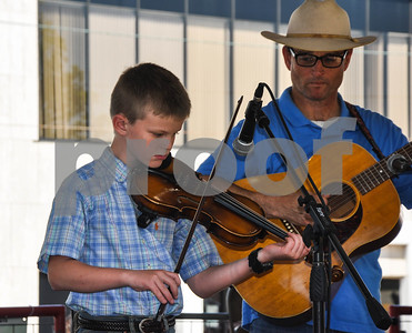 Sawyer Sullens, 9, of Overton competes in his first fiddlers contest at the 87th Annual Athens Old Fiddlers Contest & Reunion on Saturday, May 26. (Jessica T. Payne/Tyler Paper)