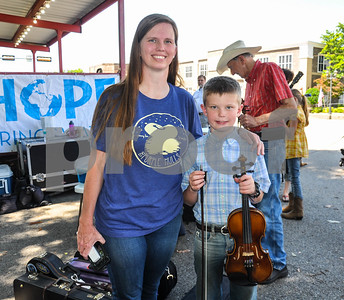 Sawyer Sullens (right) poses for a picture with his mom Dinah Sullens (left) of Overton before taking the stage to compete in the Small Fry 9 & Under Division at the 87th Annual Old Fiddles Contest & Reunion in Athens on Saturday, May 26. (Jessica T. Payne/Tyler Paper)