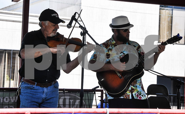 Mike Grinnell (left) and Nick Gillentine (right) compete at the 87th Annual Old Fiddlers Contest & Reunion on Saturday, May 26. The contest is broken down into 6 divisions and also includes a carnival, food vendors and street dance. (Jessica T. Payne/Tyler Paper)