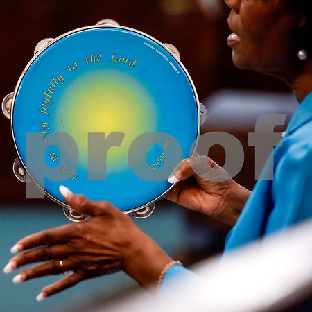 A woman plays a tambourine during the ninth annual gospel musical explosion at People's Missionary Baptist Church in Tyler, Texas, on Friday, June 16, 2017. The evening of music featured singers from around Northeast Texas. (Chelsea Purgahn/Tyler Morning Telegraph)
