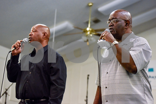 Men sing with Robert McGee, not pictured, during the ninth annual gospel musical explosion at People's Missionary Baptist Church in Tyler, Texas, on Friday, June 16, 2017. The evening of music featured singers from around Northeast Texas. (Chelsea Purgahn/Tyler Morning Telegraph)