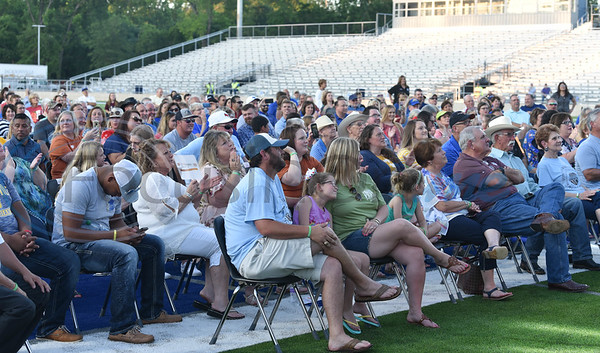 Special guests enjoy a Neal McCoy concert on the field of the Tomato Bowl in Jacksonville on Friday, June 7. The concert was part of the Grand Re-Opening and Ribbon Cutting Ceremony for the newly renovated historic stadium. (Jessica T. Payne/Tyler Morning Telegraph)
