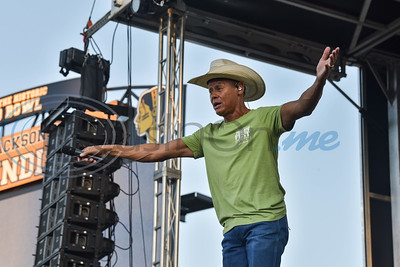 Country music star Neal McCoy gets the crowd going at a concert as part of the Grand Re-Opening and Ribbon Cutting of the historic Tomato Bowl. Neal graduated from Jacksonville High School in 1976. The free admission event took place on Friday, June 7. (Jessica T. Payne/Tyler Morning Telegraph)