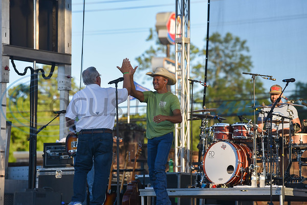 Jacksonville Mayor Randy Gorham high fives country singer and Jacksonville native Neal McCoy during a free admissions concert on Friday, June 7. The concert was part of the Grand Re-Opening and Ribbon Cutting Ceremony for the newly renovated historic Tomato Bowl. (Jessica T. Payne/Tyler Morning Telegraph)