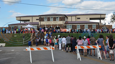 Lines for a free admission Neal McCoy concert form outside the Tomato Bowl on Friday, June 7. The concert was party of a special Grand Re-Opening and Ribbon Cutting for the historic stadium after more than a year of renovations. (Jessica T. Payne/Tyler Morning Telegraph)