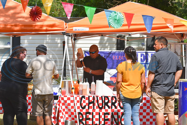 A Shabbos Churros employee makes a churro relleno at the Latin Heritage Music Festival in Palestine on Saturday, September 14. The first-time festival was held in Old Town Palestine and included authentic Mexican cuisine, live music, bounce houses, face painting and more. (Jessica T. Payne/Tyler Morning Telegraph)