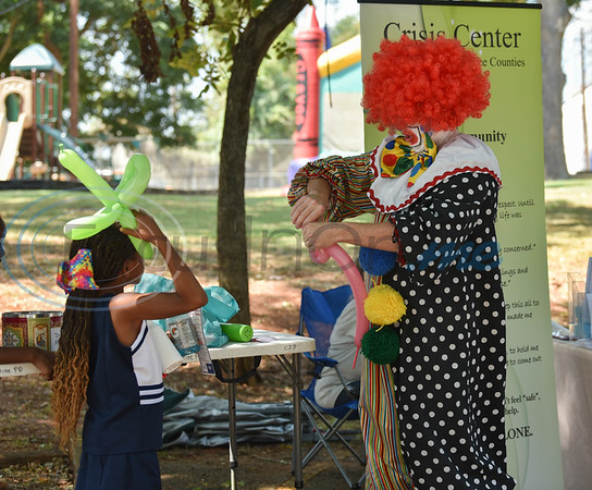 Happy the Clown makes an animal balloon for a young girl at the Latin Heritage Music Festival in Palestine on Saturday, September 14. The event was a family affair to celebrate the beautiful culture of the Hispanic people. (Jessica T. Payne/Tyler Morning Telegraph)
