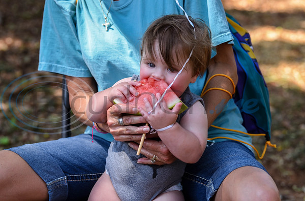 Nine month old Henry Assenheimer enjoys a slice of watermelon at Palestine's first Latin Heritage Music Festival on Saturday, September 14. The event was a family affair to celebrate the beautiful culture of the Hispanic people. (Jessica T. Payne/Tyler Morning Telegraph)