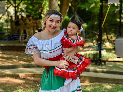 Cairo Gonzales and her daughter Mila Gonzales smile for a photo in authentic Latin dress while attending Palestine's first Latin Heritage Music Festival on Saturday, September 14. The event was a family affair to celebrate the beautiful culture of the Hispanic people. (Jessica T. Payne/Tyler Morning Telegraph)