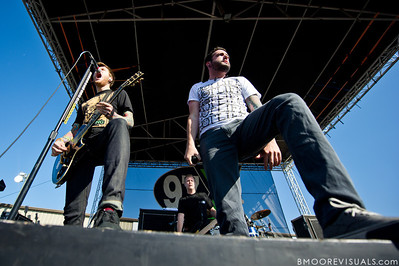 "Neil Westfall, Joshua Woodard, and Jeremy McKinnon of A Day To Remember perform in support of ""What Separates Me from You"" on December 5, 2010 during 97X Next Big Thing at 1-800-ASK-GARY Amphitheatre in Tampa, Florida"