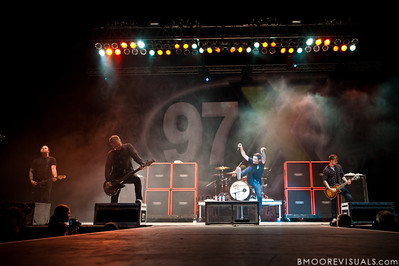 Kevin Skaff, Joshua Woodard, Jeremy McKinnon, and Neil Westfall of A Day To Remember perform on December 3, 2011 during 97X Next Big Thing at 1-800-ASK-GARY Amphitheatre in Tampa, Florida