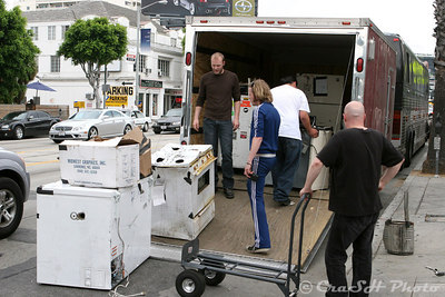 The band begins to unload the percussion section from the trailer.  They have lived out of their tour bus for the entire tour.