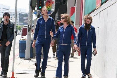 "The obligatory stroll down Sunset. They look more like members of a soccer team than a rock band. For the 10+ years they have been together, they still sport the the same track suits.  And is pretty much the only thing they have worn for their 3 week  U.S. tour. To quote Kristopher ""It works out great.  You don't need to bring a lot luggage on tour."""