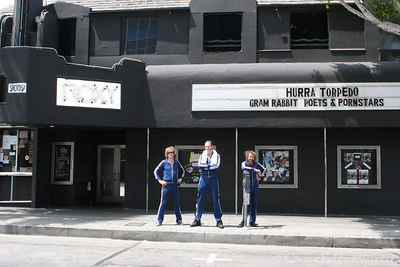 The band poses in front of the Roxy.  As I dart out into the middle of Sunset Blvd. to get this shot. From left to right: Aslag, Kristopher, and Egil.