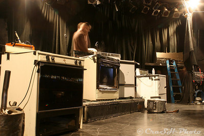 Mads, the tour manager, testing the acousical resonance of the appliances.