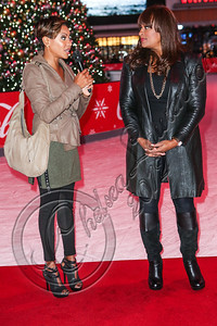 LOS ANGELES, CA - DECEMBER 14:  Rappers MC Lyte (L) and Yo-Yo attend AEG's season of giving honoring YoYo School of Hip Hop at Nokia Plaza L.A. LIVE on December 14, 2012 in Los Angeles, California.  (Photo by Chelsea Lauren/WireImage)