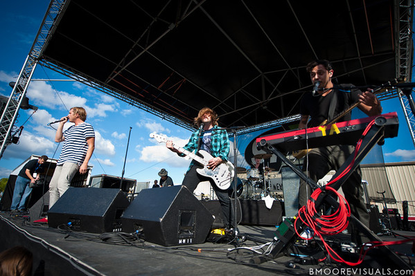 Aaron Bruno, David Amezcua, and Kenny Carkeet of AWOLNATION perform on December 3, 2011 during 97X Next Big Thing at 1-800-ASK-GARY Amphitheatre in Tampa, Florida