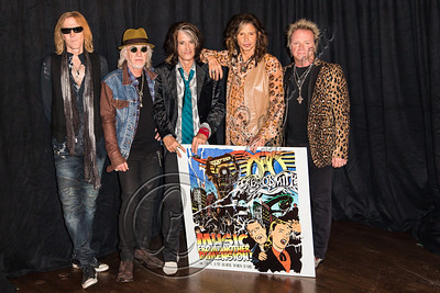 WEST HOLLYWOOD, CA - SEPTEMBER 18:  (L-R) Bassist Tom Hamilton, guitarist Brad Whitford, guitarist Joe Perry, vocalist Steven Tyler and drummer Joey Kramer of Aerosmith pose at House of Blues Sunset Strip on September 18, 2012 in West Hollywood, California.  (Photo by Chelsea Lauren/WireImage)