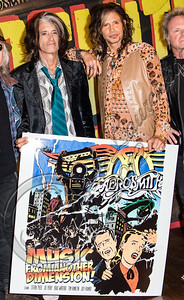 WEST HOLLYWOOD, CA - SEPTEMBER 18:  Guitarist Joe Perry (L) and vocalist Steven Tyler of Aerosmith pose at House of Blues Sunset Strip on September 18, 2012 in West Hollywood, California.  (Photo by Chelsea Lauren/WireImage)