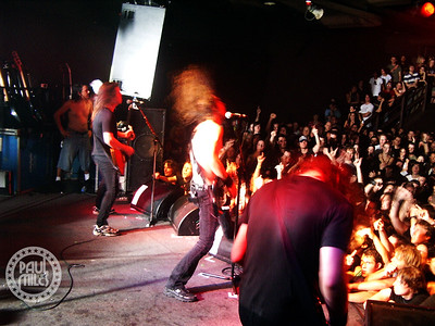 The sold-out hometown crowd loves the high-energy stage performance of Australia's young rockers Airbourne.