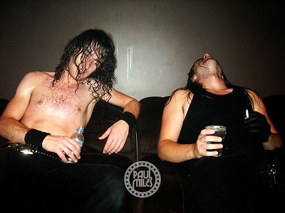 Exhausted after giving their all to a sold-out crowd, Airbourne brothers Joel and Ryan O'Keeffe take a rest in their dressing room moments after coming off stage at Melbourne's HiFi Bar & Ballroom in the hot summer of January 2008.