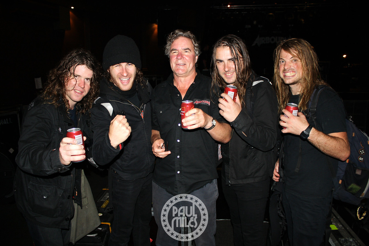Dennis O'Keeffe flanked by his sons Joel and Ryan and the other Airbourne members following their hometown show at Melbourne's HiFi Bar & Ballroom.