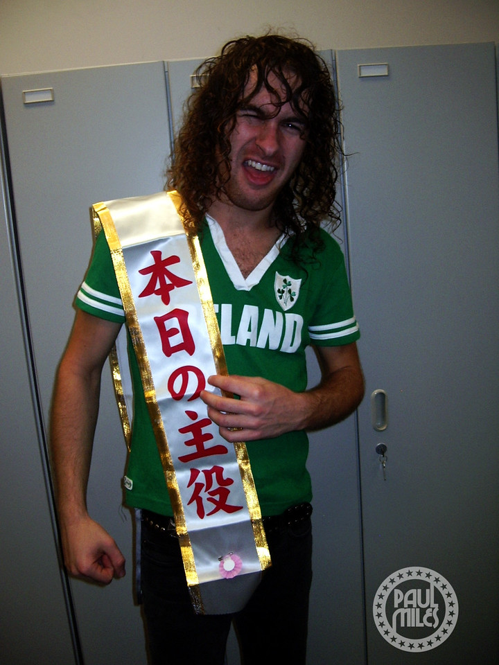 "Airbourne front man Joel O'Keeffe backstage in Tokyo after the band's first Japanese show, sporting a gift from a fan that says ""The Star of the Day!"""