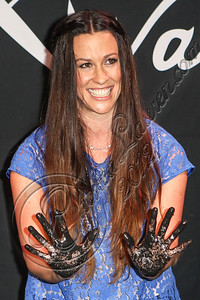 HOLLYWOOD, CA - AUGUST 21:  Singer-songwriter Alanis Morissette attends her Rockwalk induction ceremony at Guitar Center on August 21, 2012 in Hollywood, California.  (Photo by Chelsea Lauren/WireImage)