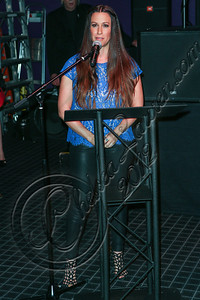 HOLLYWOOD, CA - AUGUST 21:  Singer-songwriter Alanis Morissette speaks at her Rockwalk induction ceremony at Guitar Center on August 21, 2012 in Hollywood, California.  (Photo by Chelsea Lauren/WireImage)
