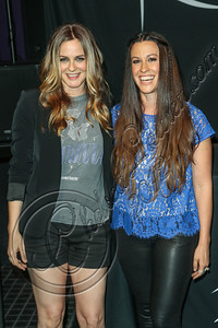 HOLLYWOOD, CA - AUGUST 21:  Actress Alicia Silverstone (L) and singer-songwriter Alanis Morissette attend Alanis Morissette's Rockwalk induction ceremony at Guitar Center on August 21, 2012 in Hollywood, California.  (Photo by Chelsea Lauren/WireImage)
