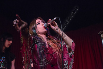 HOLLYWOOD, CA - NOVEMBER 09:  Singer Alexandra Starlight performs at The Hotel Cafe on November 9, 2012 in Hollywood, California.  (Photo by Chelsea Lauren/WireImage)