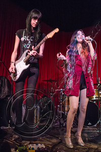HOLLYWOOD, CA - NOVEMBER 09:  Guitarist Zachary James (L) and singer Alexandra Starlight perform at The Hotel Cafe on November 9, 2012 in Hollywood, California.  (Photo by Chelsea Lauren/WireImage)