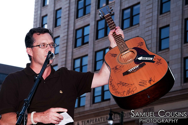 Herb Ivy, of WBLM, giving away a signed guitar  at Alive at Five concert series in Monument Square