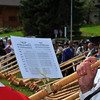 NENDAZ, SWITZERLAND – JULY 24: Happy player with his sheet music at the closing ceremony of the 10th International Festival of Alpine horns :  July 24, 2011 in Nendaz Switzerland
