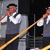 NENDAZ, SWITZERLAND – JULY 24: 2nd Place Alphornquartett Surental performing at the 10th International Festival of Alpine horns :  July 24, 2011 in Nendaz Switzerland