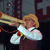 NENDAZ, SWITZERLAND – JULY 24: third place Rolf Birchler playing a Buechler alpine horn at the 10th International Festival of Alpine horns :  July 24, 2011 in Nendaz Switzerland
