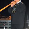 NENDAZ, SWITZERLAND - JULY 24: Finalist Max Hartmeier performing  at the 10th International Festival of Alpine horns :  July 24, 2011 in Nendaz Switzerland