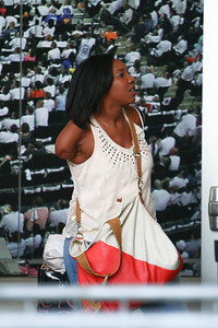 Deondra Scott enters the door leading to the American Idol Auditions 2012 - Charlotte NC. Time Warner Cable Arena. Her singing career was put on hold after a horrific boating accident on Lake Norman in which she lost her arm.