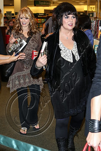 "LOS ANGELES, CA - SEPTEMBER 27:  Vocalist Ann Wilson (L) and guitarist Nancy Wilson of ""Heart"" arrive at the signing of their memoir ""Kicking and Dreaming"" at Barnes & Noble bookstore at The Grove on September 27, 2012 in Los Angeles, California.  (Photo by Chelsea Lauren/WireImage)"