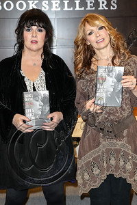"LOS ANGELES, CA - SEPTEMBER 27:  Vocalist Ann Wilson (L) and guitarist Nancy Wilson of ""Heart"" attend a signing of their memoir ""Kicking and Dreaming"" at Barnes & Noble bookstore at The Grove on September 27, 2012 in Los Angeles, California.  (Photo by Chelsea Lauren/WireImage)"