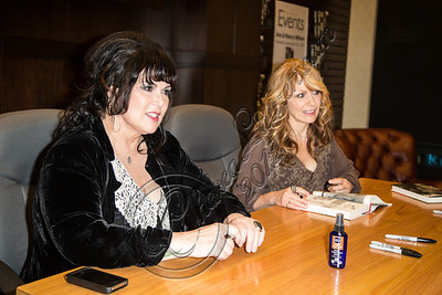"LOS ANGELES, CA - SEPTEMBER 27:  Vocalist Ann Wilson (L) and guitarist Nancy Wilson of ""Heart"" sign copies of their memoir ""Kicking and Dreaming"" at Barnes & Noble bookstore at The Grove on September 27, 2012 in Los Angeles, California.  (Photo by Chelsea Lauren/WireImage)"