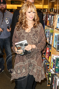 "LOS ANGELES, CA - SEPTEMBER 27:  Guitarist Nancy Wilson of ""Heart"" arrives at the signing of her memoir ""Kicking and Dreaming"" at Barnes & Noble bookstore at The Grove on September 27, 2012 in Los Angeles, California.  (Photo by Chelsea Lauren/WireImage)"