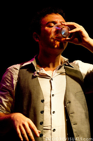 Dan Nigro of As Tall As Lions pauses for a drink during the band's performance on May 2, 2010 at State Theatre in St. Petersburg, Florida