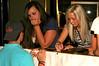 Courtney Arnold and Hali Hicks sign autographs.