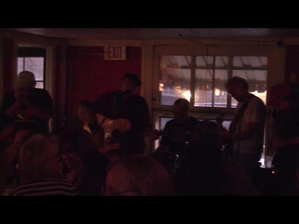 Scott Ballantine (guitar), Jack Clarke (harmonica), Kevin Hughey (drums), Dave Langfitt (pedal steel), Joe Langfitt (bass) and Stanley Smith (clarinet and vocals).