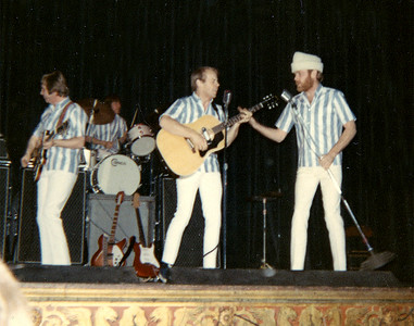 Al Jardine gets a hand from Mike Love.