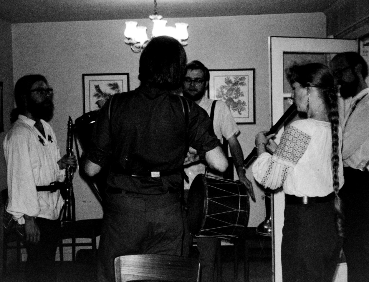 """The 1974 camp at Sweet's Mill inspired people to play Balkan music at home. For instance,  Peter Ward started the band """"Sviraći""""  -- which practiced weekly in our living room in Menlo Park, CA.  Mike Gage, Lew Smith, Melissa Miller, Jim Little (and bass player Cliff Walters, not pictured) were early members. [Lew, Melissa, and Jim have continued Sviraći for decades.]"""