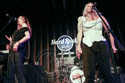 HOLLYWOOD, CA - OCTOBER 11:  Singers Keren Woodward (L) and Sara Dallin of Bananarama perform at Hard Rock Cafe's 13th Annual 'PINKTOBER' Breast Cancer Awareness Campaign at Hard Rock Cafe - Hollywood on October 11, 2012 in Hollywood, California.  (Photo by Chelsea Lauren/WireImage)