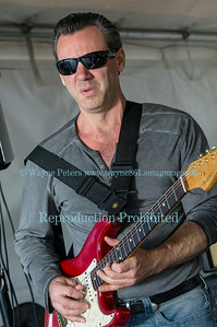 Tommy Z at Crossborder Blues, Brews and Que in Wilson, NY on June 14, 2014, were he won as the top original band.